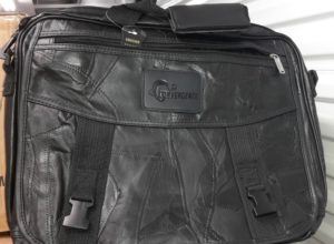 leather laptop bag with CONevrgence logo stamped into a leather rectangle