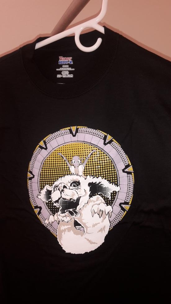 5a6a9a2041 T-shirt with Connie riding Falkor through a Stargate