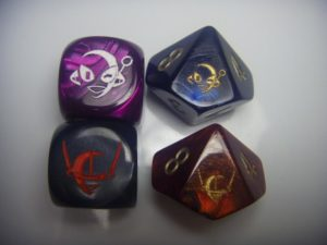 multicolored D6 and D10 dice with Connie and Connie Mark 2 heads on them
