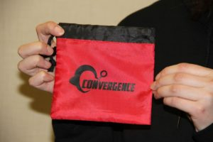 Small red drawstring bag with CONvergence logo