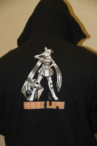 "CONvergence Hoodie showing COnnie wearing pieces of different cosplays; reads ""Geek Life"" under her feet"
