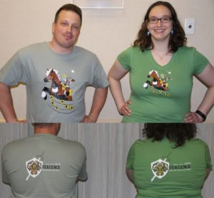 Man and Woman modeling t-shirts featuring Connie dressed as Link, riding a horse. CONvergence Logo made to look like Zelda logo.