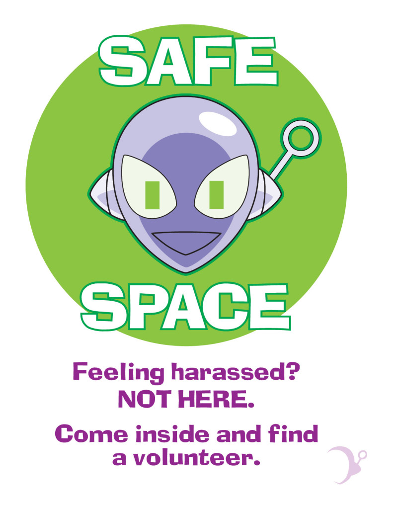 "Poster showing Connie smiling, reads, ""SAFE SPACE. Feeling Harassed? NOT HERE. Come inside and find a volunteer."""