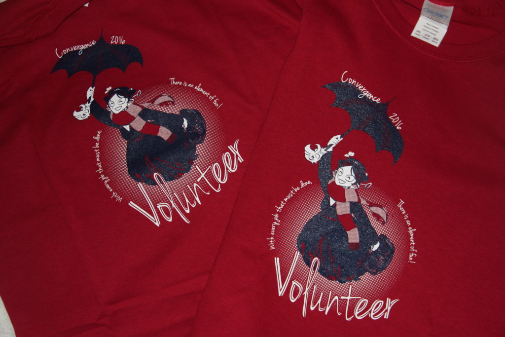 """maroon t-shirt depicting Connie as Mary Poppins, flying on an umbrella. Reads. """"Volunteer"""""""