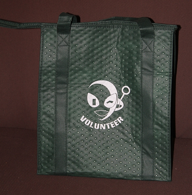 """an insulated bag with connie winking printed on it. Reads, """"volunteer"""""""