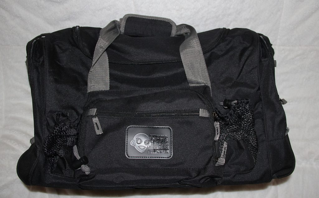 black duffel bag with CONvergence Uber Volunteer stamped onto the front